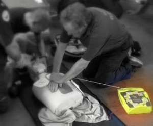 Members practising CPR with an AED.