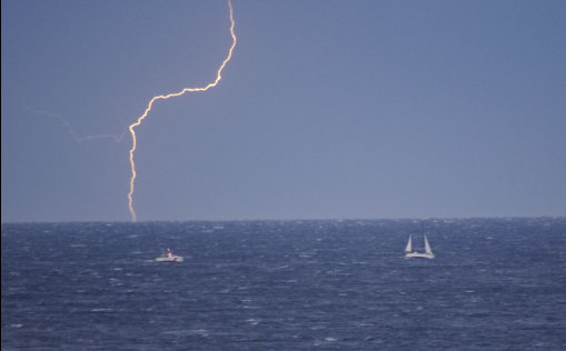 Lightning strikes the horizon behind MH30.